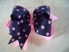Pink and Navy Polka Dot Boutique Bow. $9.99, via Etsy.