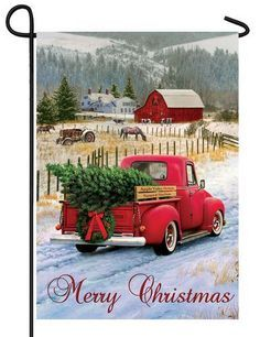 Country Christmas pickup truck themed garden flag with an antique red truck hauling a freshly cut Christmas tree home to decorate for the Holidays. The snow covered setting is complete with a bright,