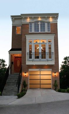 A traditional townhouse updated with a modern garage door.