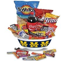 Spoil you favorite fan with a mountain of yummy treats arranged in a keepsake U of M party bowl.