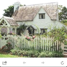 I so want to live in this sweet little cottage by the sea.