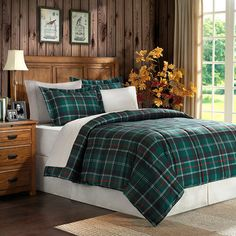 Outfit your guest room or master suite in eye-catching style with this plaid comforter set, featuring a reversible design.   Produc...