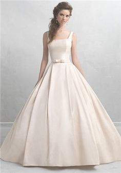 If ever there was a gown that embodied sweetness, it's this creamy satin ballgown. Its only ornamentation is a small bow at the waist, while the square