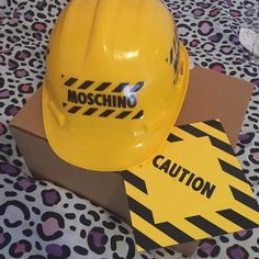 RARE Moschino Hard Hat Collectable❤️ Rare moschino hard hat from the open for construction runway collection❤️ Only sent to those who were invited to the show! comes with real hard hat and invite! love this to death but i just need the money for school atm❤️ Moschino Accessories