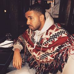 Drake wears a chic Chanel poncho.