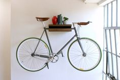 A bike shelf! Instead of hiding the bike, we could use it as decoration. Granted, a mud-caked road bike may not look as elegant as the old timey one in the photo. Sas Entree, Indoor Bike Rack, Bike Shelf, Rack Shelf, Storage Racks, Storage Systems, Storage Ideas, Range Velo, Bike Hanger