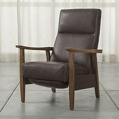 Greer Leather Recliner -black would be better in a room with wall color or burnt orange or yellow in a room with white walls.