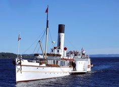 """""""Skibladner"""" - Lake Mjøsa white swan. The world's oldest preserved paddle steamer in timetabled service, with live steam engines, paddle wheels and a speed of 12 knots. """"Skibladner"""" is the pride of Norway's inland, and one of  Norway's best-loved tourist attractions. You can easily make a day trip on her if you are staying in the Oslo area – or planning to visit Lillehammer. http://www.skibladner.no/index.htm"""