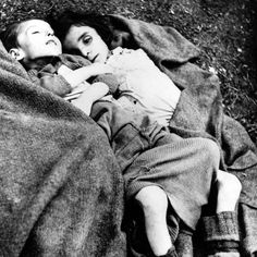 The corpses of two children at Bergen-Belsen.  Anne Frank, along with her family, was deported to Bergen-Belsen just weeks before the liberation of her hometown of Amsterdam.  She and her family, with the exception of her father, died of Typhus soon after their arrival at the camp.