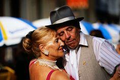 Linger on a street corner, watching tango