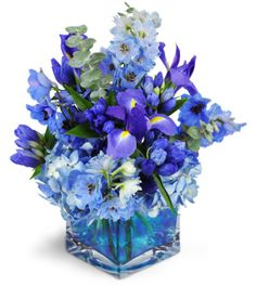 Stunning azure hues flow through this modern, monochromatic arrangement. It's perfect to celebrate your favorite guy, or a new baby boy, in exquisite style.