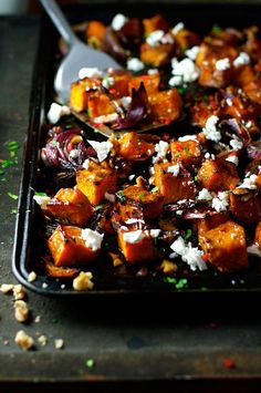Roasted pumpkin with maple syrup, walnuts, roasted pumpkin seeds, chilli and feta. My new favourite way with pumpkin!