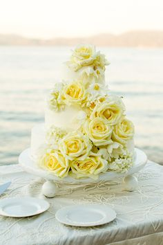 White wedding cake from @tellierm. Lake Tahoe wedding by @ofdevents , @mikelarson , @blueprintst , @cprandtents , @latavola