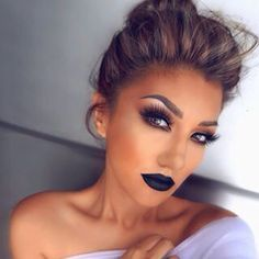 Flawless makeup. Smokey eye, winged liner, contour, perfect brow, and indigo lip stain. Perfection.