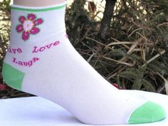 Live, Laugh, Love-Sport, Cycling and Athletic Socks by Minnesota Custom Woolens, Inc.. $7.95. Live, Laugh, Love-Words to Keep you Moving. Great for cycling or walking the town. Made of 70% Coolmax, 10% Cotton, 15% Lycra Spandex and 5% nylon. Available in size medium only. A medium fits a woman's shoe size 6 1/2-10.