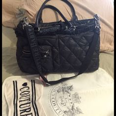 Juicy Couture Diaper Bag  Black quilted nylon diaper bag. Lots of pockets and places to store all your baby essentials in this adorable authentic juicy couture diaper bag that comes with both a shoulder and baby carriage strap. 2 inside bottle upright pockets, a changing pad, and a couture burp cloth! Some stains on lining but no tears. Used but in good condition. Juicy Couture Bags Baby Bags