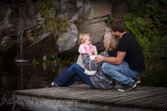 A casual look for this portrait of a young family on dock at Silver Lake near Parry Sound. by Bayshore Photography @Bayshore Photography