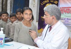 GURGAON TAURU TOWN Lions Club (INDIA) | Lions conducted a health check up in local primary school and provided a mid day meal