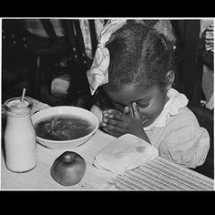 Black Archive : found African American girlchild praying before meal with pigtails, hair bows and ruffled dress 1950's