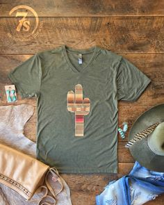 The Saguaro! Serape Saguaro Cactus graphic on a super-soft tri-blend olive tee -- who doesn't need this in their closet for spring?! #cactus #saguaro #savannah7s #savannahsevens