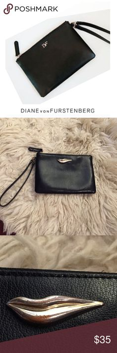 """Diane Von Furstenberg DVF Black Leather Wristlet Diane Von Furstenberg DVF Black Leather Wristlet. Flirty lips. Authentication on the tag. Approx 7"""" by 5"""". Has some tarnish on the silver pewter accent. Gently worn. Good condition. Feel free to make an offer or bundle & save! Diane Von Furstenberg Bags Clutches & Wristlets"""