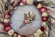All the pinks for this large dried flower hoop and buttonhole. The hoop is adorned with dried flowers and was made to be used as a centrepiece with a candelabra to stand in the middle.  #driedflowers #meadowandbloom #driedflowerhoop #driedflowerbuttonhole #driedflowerbouquet #flowerhoop #floralhoop #centrepiece #rusticwedding #pinkflowers #helichrysum #lavender #weddinginspiration #bohowedding #bridalflowers #weddingflowers