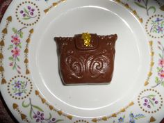 Stylin' Milk chocolate clutch in a retro style with a pop of Angel flakes that are edible. On a Harrod's bone china plate. Great for your basic High Tea with girlfriend's.