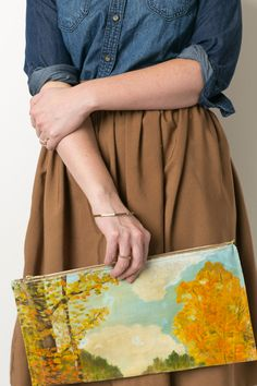 The House That Lars Built.: Painted canvas clutch