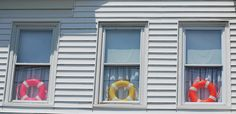Life saver rings in the window. Via Flickr.