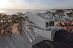 Stacked concrete blocks and roof deck give diners sea views at South Korean cafe