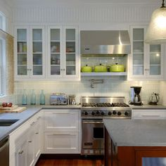 white cabinets, modern fixtures, subway tile