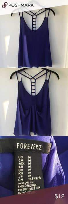 EUC Forever 21 Ladder-Back Tank in Royal Blue EUC Forever 21 Ladder-Back Tank in Royal Blue. Great on its own or under a jacket. Super flattering. Submit reasonable offers via the 'Offer' function. NO negotiating in comments section, trading or offline transactions. All items from my closet, in a smoke-free, dog friendly home. Forever 21 Tops Tank Tops