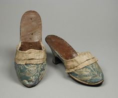 Pair of Woman's Shoes (Mules)  Germany or Italy, 1770-1780  Costumes; Accessories  Silk plain weave with silk supplementary weft-float patterning, silk plain-weave trim, and leather