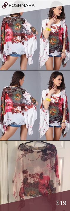 "SALE!🌺HP 12/17🌺White Floral Sheer Chiffon Poncho Wide loose & flowy cold shoulder poncho. Sheer/see through.   Print placement may differ from stock photo.  White is brighter than it looks in last photo.  24.5"" length.  100% polyester. Tops"