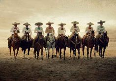 Riding off into the sunset looks even cooler when done by charros.