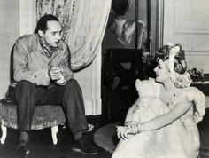 Rene Clair directs Marlene Dietrich on the set of The Flame of New Orleans. 1941.