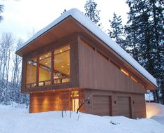 An 800-square-foot cabin with a simple shed roof offers a modern update. While the roof provides the right structure to withstand and shed the snow, the slope creates a room that can be all windows. seattle - FINNE Architects