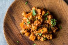Sweet Potato Chana Masala (Minus onions, garam masala, chile, cilantro. Add mustard seeds.)