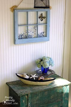 Brittany's screen porch makeover involves a shower curtain, a minnow trap, a rickety ladder and a bamboo rug. Her screen porch decorating ideas are totally fun and refreshing. Window Pane Art, Window Frames, Window Ideas, Old Windows, Windows And Doors, Barn Windows, Vintage Windows, Screened Porch Decorating, Screened Porches