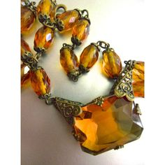 Art Deco CZECH Amber Glass Necklace, Filigree, Brass, Signed Vintage ($105) ❤ liked on Polyvore featuring jewelry, necklaces, glass jewelry, brass necklace, vintage glass necklace, art deco necklace and vintage jewelry