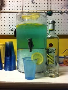 """""""Ocean Water""""... 1 bottle Bicardi Limon, 2 Liter of 7up, and a few drops of blue food coloring!"""