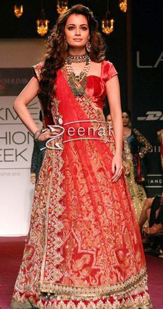 Bollywood Beauty Dia Mirza showcases a creation by Designers Shyaml and Bhumika during the Lakme Fashion Week (LFW) Winter/Festival 2013 in Mumbai. She is completely hidden in threads and motifs head to toe. Amazing craftsmanship is done over her dress, designer velvet choli add more elegant catch to her outfit.