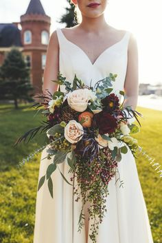 Gorgeous fall cascading wedding bouquet. Designed by Hilltop Florist and Greenhouse Mankato, MN.