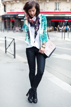 Coated skinnies, a white top tucked in, a patterned jacket, a patterned scarf and a patterned bag for the more = more look