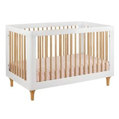 Made from eco-friendly materials, the Babyletto Lolly 3-in-1 Convertible Crib with Toddler Rail features curved corners, tapered feet and contrasting neutral colors. Plus, it is built to last as it converts from a crib with four mattress levels to a toddler bed and finally to a daybed.
