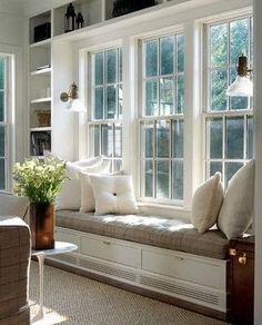 bookshelves and bench seat around windows in formal living room