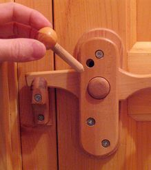 Wooden door knobs & latches  Working on a Man-cave for my son. He wants a half door on the bar. This would be a neat latch to keep the toddlers out.