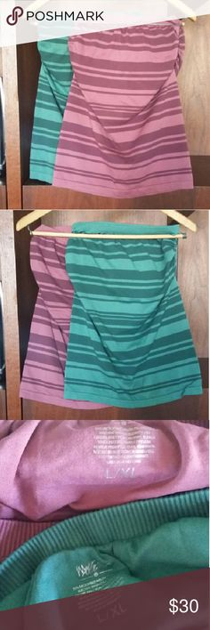 Two striped tube tops Stretchy tube tops with built-in shelf bra. L/XL fits like a non-skin-tight medium. (I wear a small tee and 34DD bra.) Worn once each; EUC. Mossimo Supply Co. Tops Tank Tops