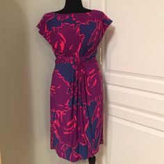 NWTJONES NEW YORK DRESS This dress is new with tags without any defects. I purchased it at Macy's at full retail price. It has a side zipper enclosure and it is fully lined. It is 95% polyester and 5% spandex. Jones New York Dresses Midi
