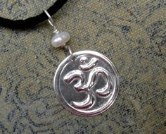 """My yoga class was canceled this afternoon due to miserable weather here in Western Oregon. It has been 6 days of snow days with no school for the kids. Momma can use some """"Oms"""". Om or Aum and Pearl Sterling Silver Pendant  by nicholasandfelice, $14.50"""